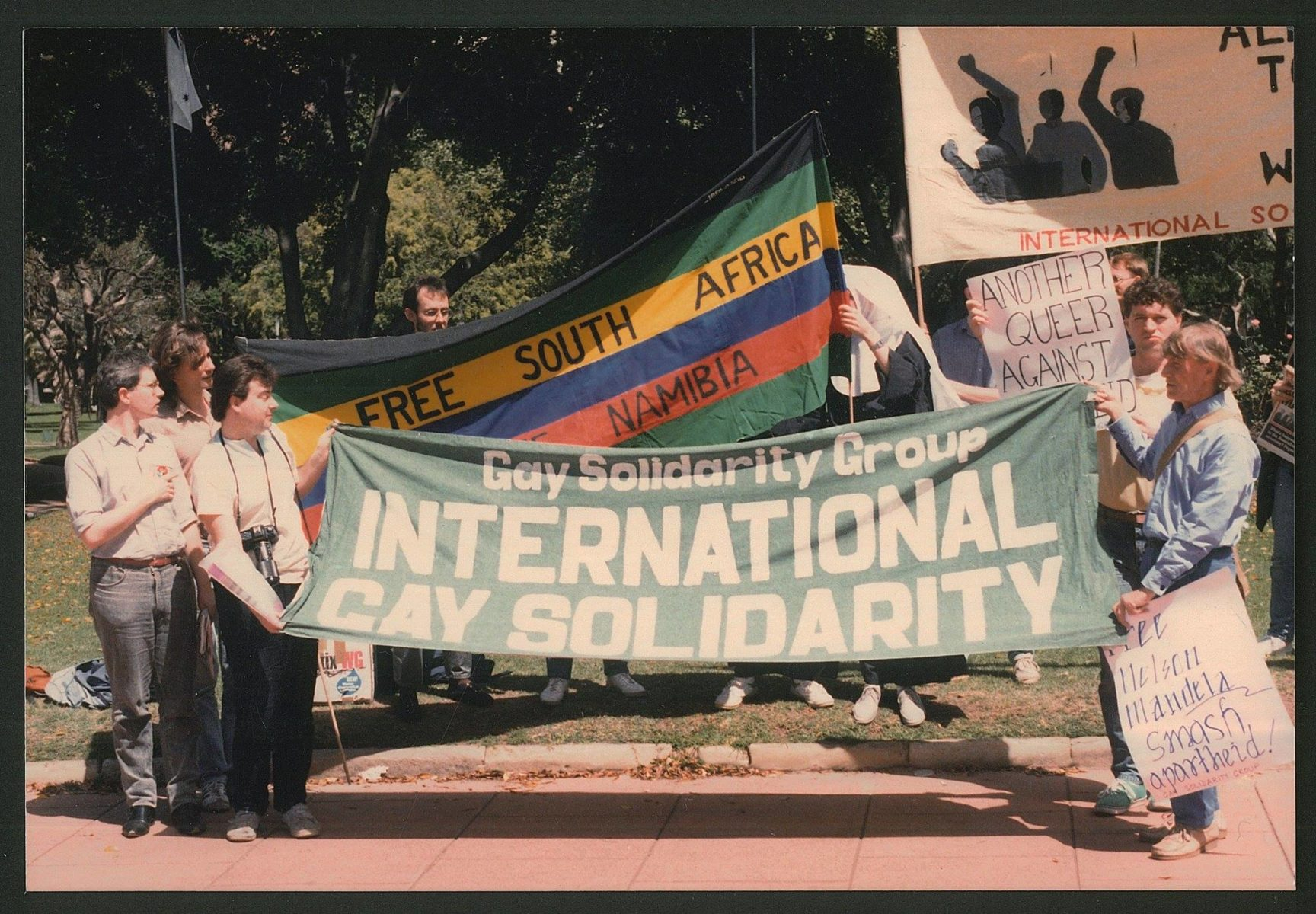 Ken Lovett (far right) with the Gay Solidarity Group at an anti-apartheid rally, Hyde Park Square, Sydney, NSW, c. March 1988