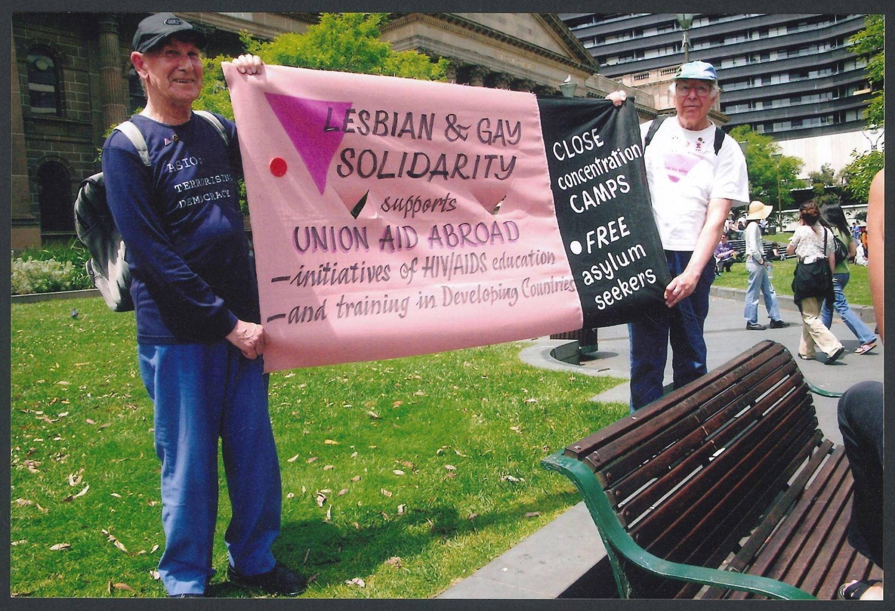 Kendall Lovett and Mannie de Saxe holding the Lesbian and Gay Solidarity banner at an 'Out of Iraq' rally, State Library of Victoria, Melbourne, 2005, (Photo: John Storey)